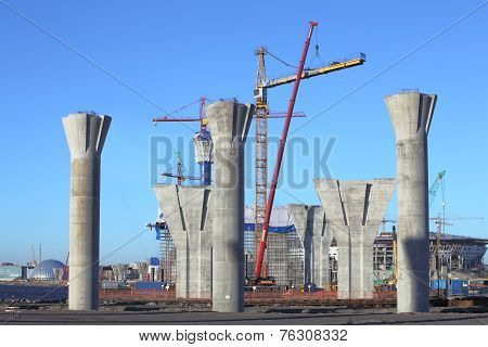 Construction Site With Concrete Supports, And Erected The Tower Crane.