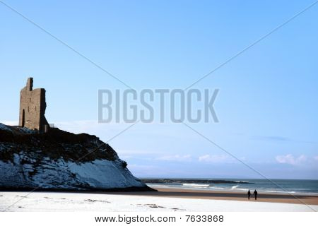 Couple Walking Beach With Castle
