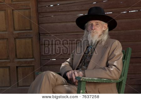 Senior Man In Western Clothing