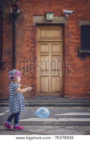 Girl with a baloon
