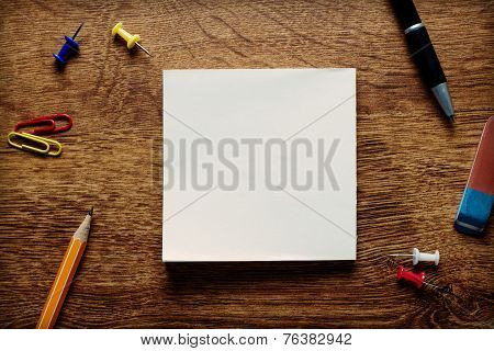 Supplies On Wooden Desk With Central Copy Space