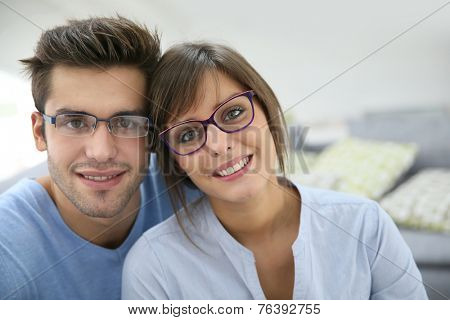 Portrait of young couple with eyeglasses on poster