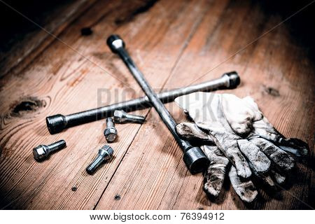 Old Used Wrench With Screw And Dirty Gloves