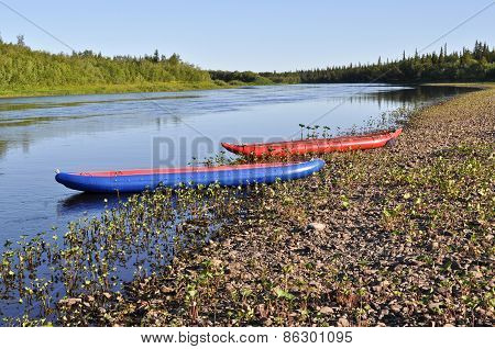 Inflatable Kayaks On  Shore Of The River.