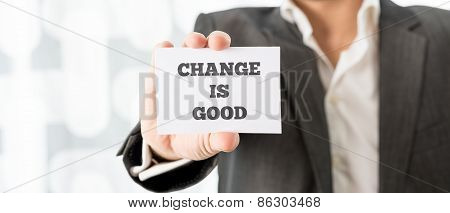 Businessman Showing Card With Change Is Good Texts