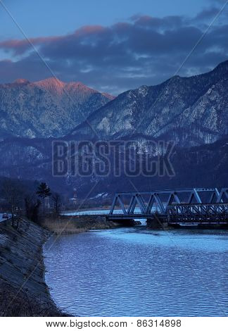 Railroad Bridge through the Carpathian Mountains, passing by the Olt Valley, Romania - sunset blue hour light