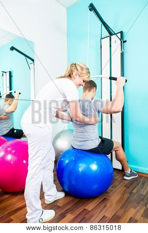Patient at the physiotherapy doing physical exercises with therapist in sport rehabilitation poster