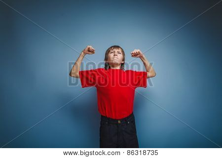 boy in red t-shirt teenager brown hair European appearance shows