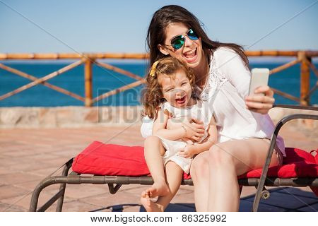 Mom And Girl Taking A Selfie