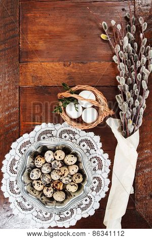 Easter Composition Of Catkins And Eggs On Wooden Table