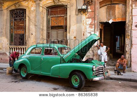 Havana - February 25: Unkown Man Washing His Old Classic Car On February 25, 2015 In Havana. These V