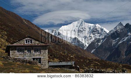 Lodge And Snow Capped Yala Peak
