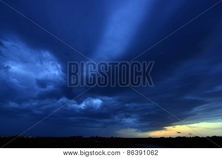 dark blue storm clouds at sunset