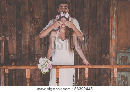 Young and beautiful bride and groom are having a good fun time and happy together while shooting a w