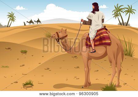 Arabian Riding Camels On The Desert