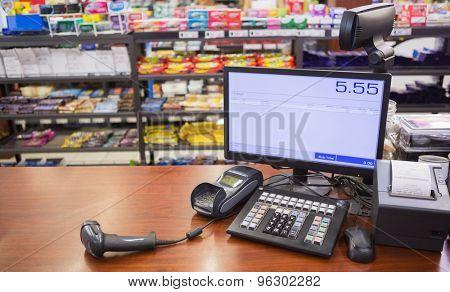 Cash register on wooden table at supermarket poster
