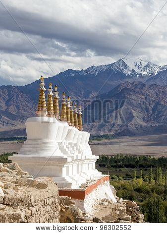Buddhist Chortens (stupa) And Himalayas Mountains In The Background Near Shey Palace In Ladakh, Indi