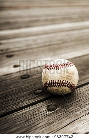 Baseball and mitt on rustic wooden background