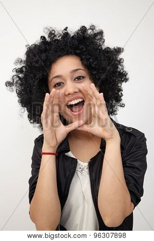 Happy girl with big afro hair shouting