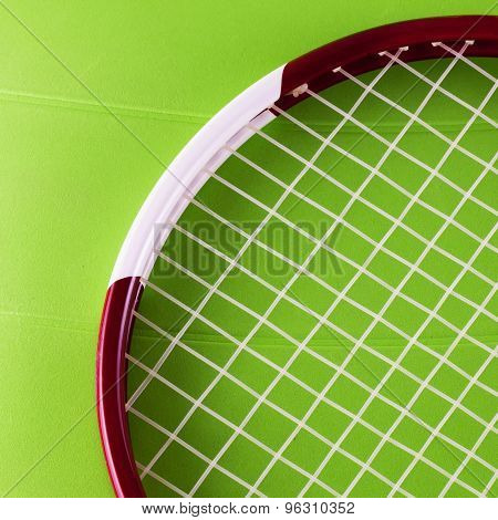 Tennis racket over green synthetic surface horizontal image poster