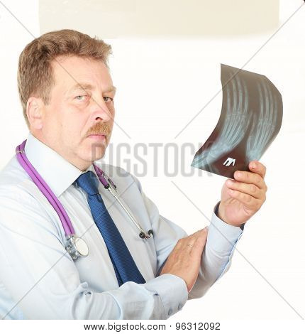 male doctor, close-up portrait,confident holding his stethoscope