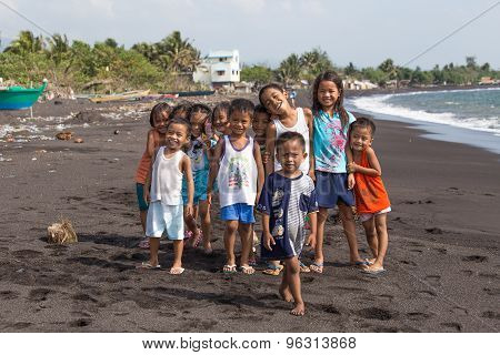 Children Group Portrait On The Beach With Volcanic Sand Near Mayon Volcano, Philippines