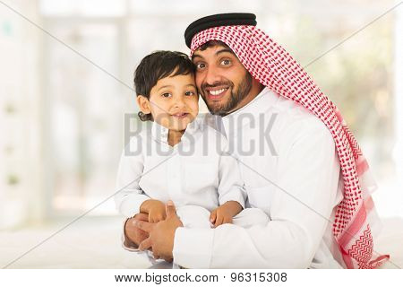 playful muslim father and his little boy
