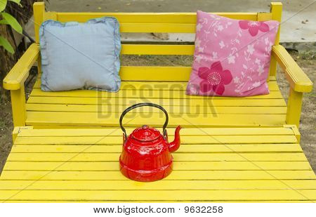 Red Pot On Yellow Garden Table