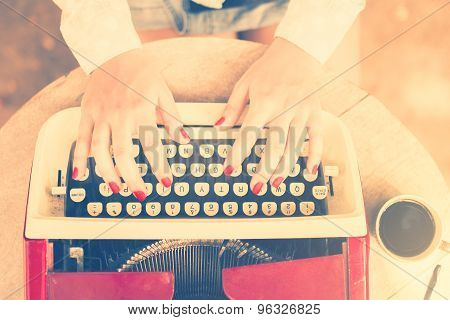 Girl At The Table Typing On A Typewriter, Vintage Photo Effect