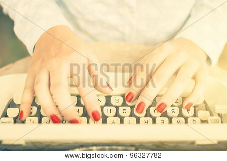Girl Typing On A Typewriter, Vintage Photo Effect