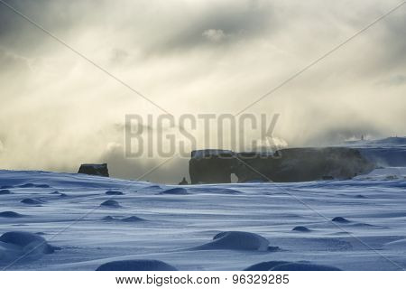 Peninsula Dyrholaey in south Iceland in winter poster