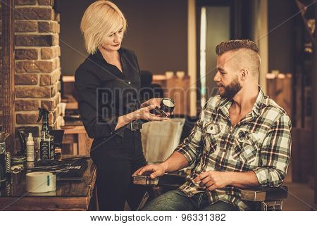Client choosing hair care product in a barber shop