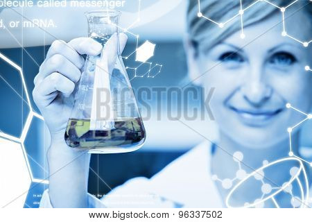 Science graphic against close up of a female scientist holding an erlenmeyer and smiling at the camera