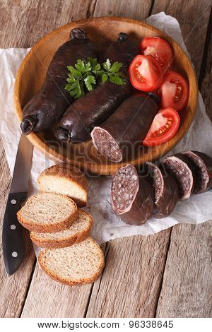 Blood Sausages And Vegetables On A Table Close-up. Vertical