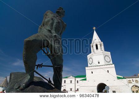 Monument to Musa Jalil and Spasskaya tower of the Kazan Kremlin. UNESCO World Heritage Site. Kazan Republic of Tatarstan Russia. poster