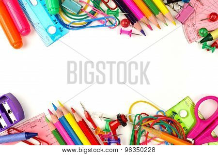 Double border of school supplies over white