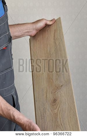 male Hands carpenter holding a laminate closeup poster