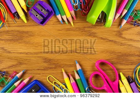 School supplies double border on wood desk