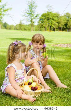 Preschool Sisters In Garden