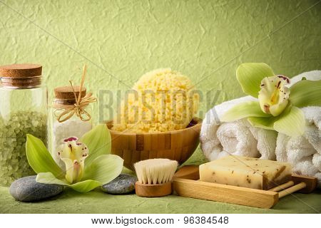 Spa still life with salt,towel,sponge,handmade soap and blooming orchid