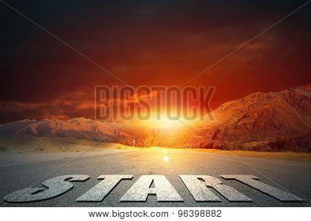 Start word on asphalt road and sunrise at horison line