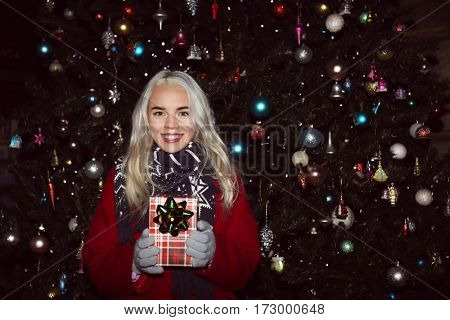 Woman with gift box on Christmas market