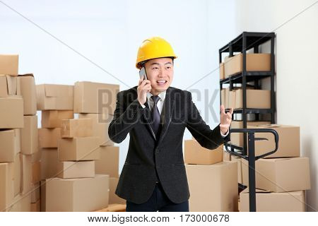 Man emotionally speaking by cellphone at warehouse