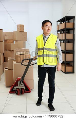 Man with loader at warehouse