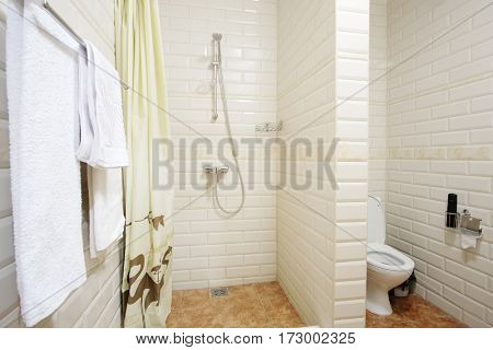 Interior of a shower room aligned with toilet