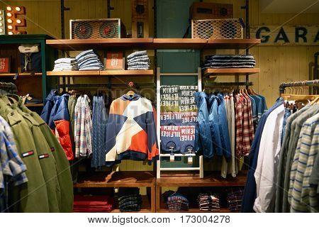 HONG KONG - CIRCA NOVEMBER, 2016: inside a Tommy Hilfiger store in Hong Kong. Shopping is a widely popular social activity in Hong Kong.