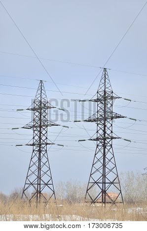 Winter Landscape With Towers Of Transmission Lines