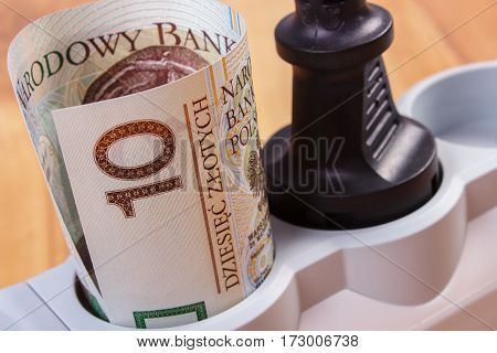 Rolls Of Polish Currency Money In Electrical Power Strip With Connected Plug, Energy Costs