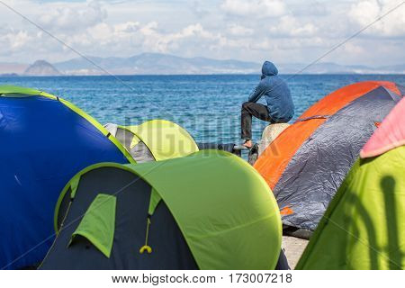 KOS ISLAND, GREECE - SEP 28, 2015: Unknown refugees arriving in Greece by inflatable boats from Turkey. Kos island is located just 4 kilometers from the Turkish coasts.
