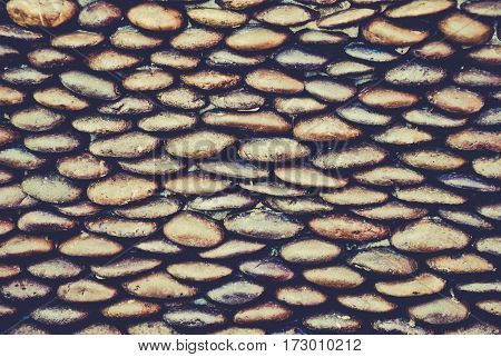 background of small gravel stone texture.Sea stones wall abstract background vintage tone